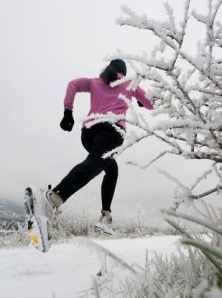 Woman trail running in winter